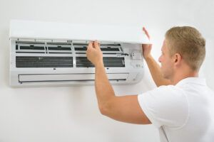 Technician installing a residential air conditioning unit in Fort Lauderdale