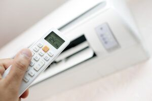 Residential Air Conditioning in Pompano Beach, FL with remote controller