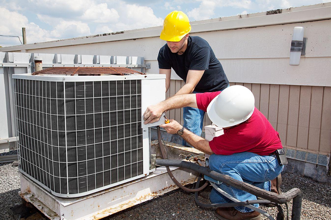 Men Performing HVAC Repair in Boca Raton on top of roof